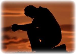 man-praying-on-one-knee